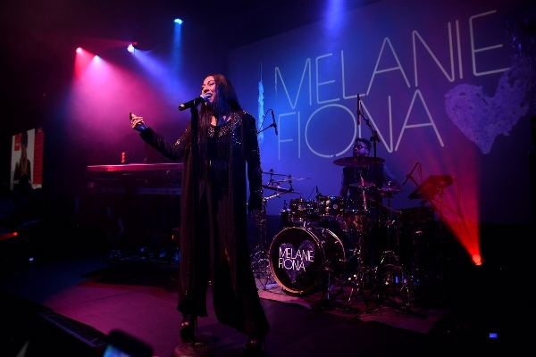 "NEW YORK, NY - MAY 15:  Melanie Fiona performs as Verizon Celebrates Consumers With ""The Big Payoff"" Featuring A Special Exclusive Performance By Melanie Fiona And Expert Entertainment Panel on May 15, 2015 in New York City.  (Photo by Bryan Bedder/Getty Images for Verizon)"